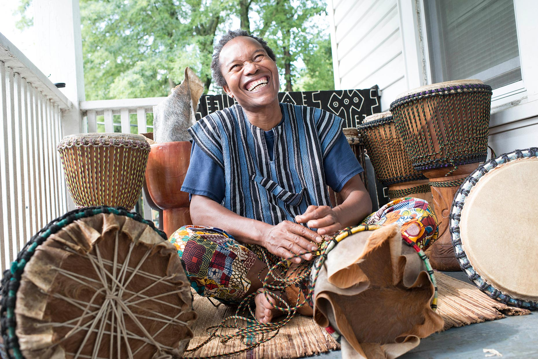 Braima Moiwai on his Durham Porch. Moiwai is a teacher, a musician, a drummaker and a bright, lovely soul.